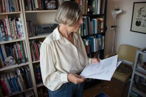 Nina Czegledy looks at more papers in her office.