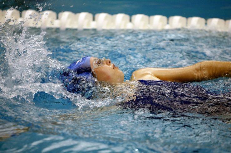 Teenage Female Athlete swimming